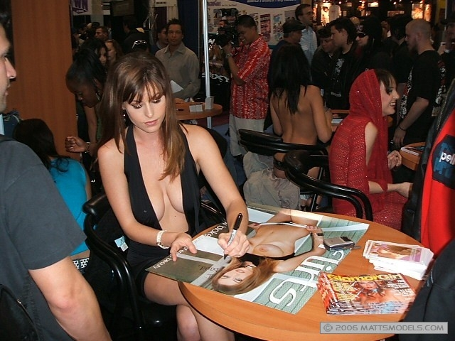 Ginger Jolie and Charlie Laine singing autographs for Andrew Blake at AVN.